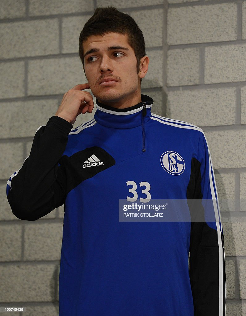Schalke´s defender Roman Neustaetter arrives for a press conference in Gelsenkirchen, western Germany on November 20, 2012 on the eve of the UEFA Champions League football match against FC Olympiacos Athens 04.