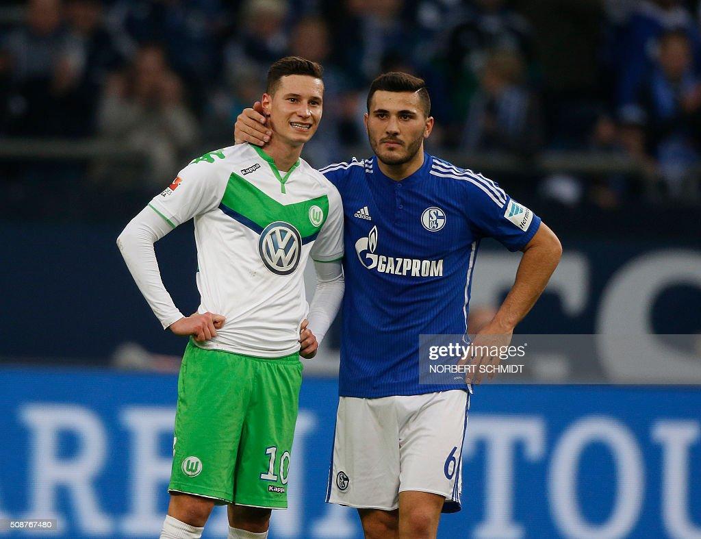 Schalke's defender Sead Kolasinac speaks with Wolfsburg's midfielder Julian Draxler (L) during the German Bundesliga first division football match FC Schalke 04 v Wolfsburg in Gelsenkirchen, western Germany on February 6, 2016. / AFP / NORBERT SCHMIDT /