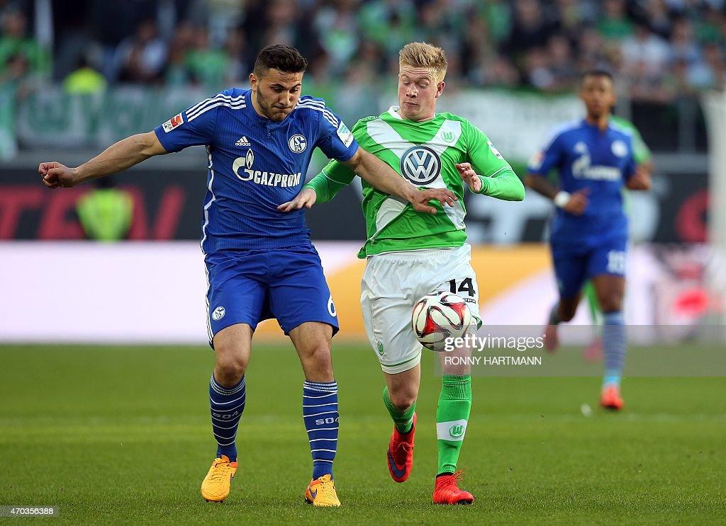 Schalke's defender Sead Kolasinac (L) vies with Wolfsburg's Belgian midfielder Kevin De Bruyne during the German first division Bundesliga football match VfL Wolfsburg vs FC Schalke 04 in Wolfsburg, central Germany, on April 19, 2015.