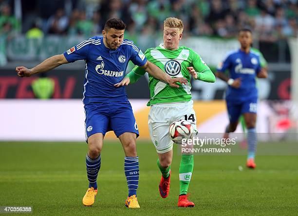 Schalke's defender Sead Kolasinac vies with Wolfsburg's Belgian midfielder Kevin De Bruyne during the German first division Bundesliga football match...