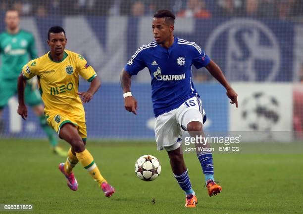 Schalke's Dennis Aogo and Sporting Lisbon's Nani