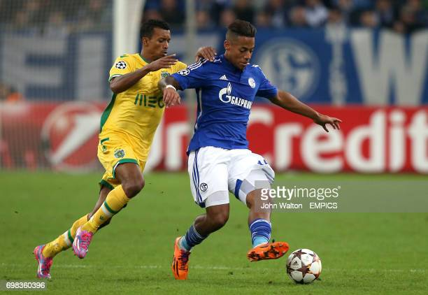 Schalke's Dennis Aogo battles for possession of the ball with Sporting's Nani