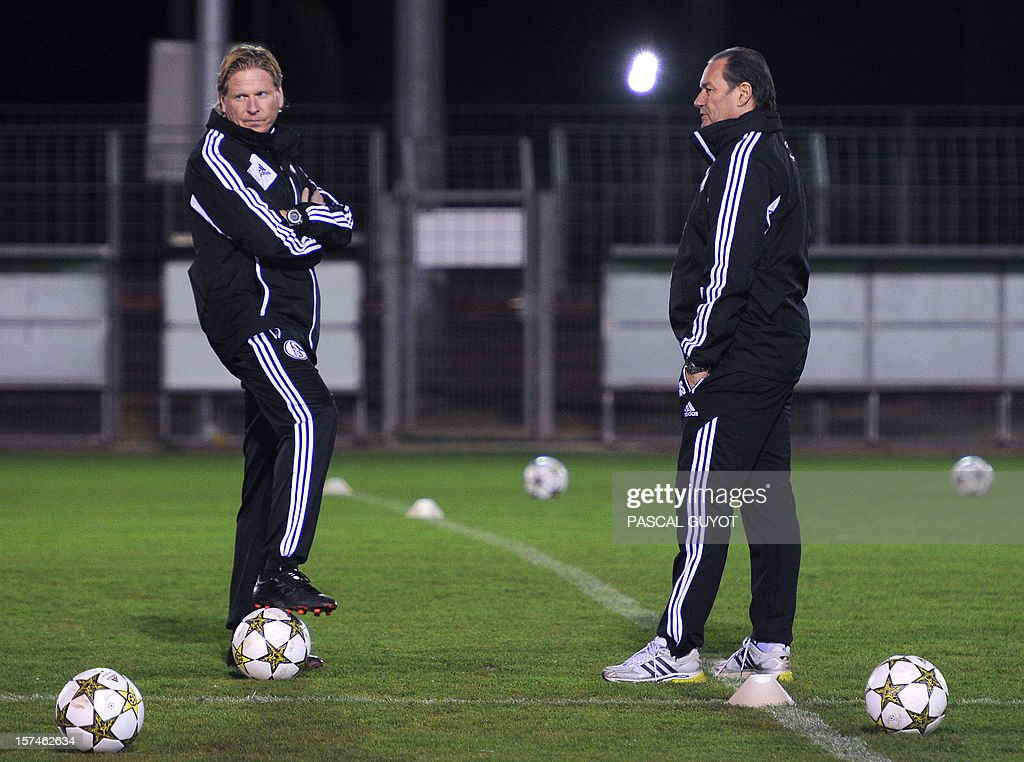 Schalke's Dutch head coach Huub Stevens (R) and assistant coach Markus Gesdol take part in a training session on December 3, 2012, at Gramont stadium in Montpellier, on the eve of the UEFA Champions League football match between Montpellier and Schalke.