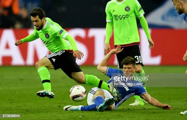 Schalke's Dutch striker KlaasJan Huntelaar and Ajax Amsterdam's midfielder Armin Younes vie for the ball during the UEFA Europa League 2ndleg...