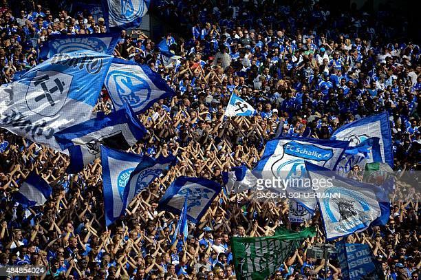 Schalke's fans cheer during the German first division Bundesliga football match FC Schalke 04 v SV Darmstadt 98 on August 22 2015 in Gelsenkirchen...