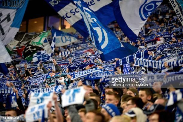 Schalke's fans cheer for their team during the German first division Bundesliga football match of Schalke 04 vs VfB Stuttgart in Gelsenkirchen...