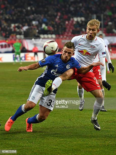 Schalke's forward Donis Avdijaj and Salzburg's Konrad Laimer vie for the ball during the UEFA Europa League Group I football match between FC...