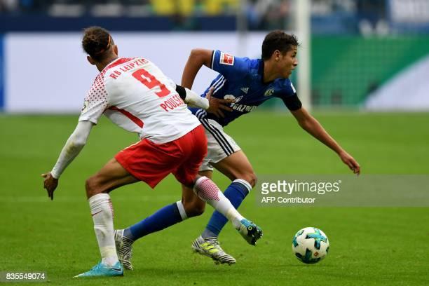 Schalke's French midfielder Amine Harit and Leipzig´s Danish striker Yussuf Poulsen vie for the ball during the German First division Bundesliga...