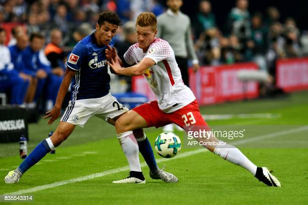 Schalke's French midfielder Amine Harit and Leipzig´s defender Marcel Halstenberg vie for the ball during the German First division Bundesliga...
