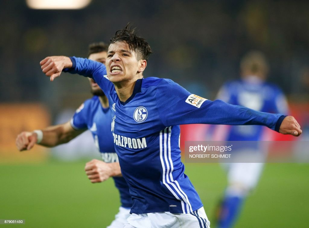 Schalke's French midfielder Amine Harit celebrates after scoring a goal during the German First division Bundesliga football match between Borussia Dortmund and FC Schalke 04 in Dortmund, western Germany, on November 25, 2017. /