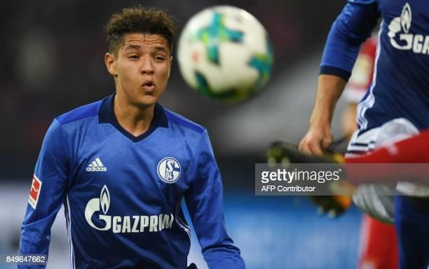 Schalke's French midfielder Amine Harit reacts during the German First division Bundesliga football match between FC Schalke 04 and FC Bayern Munich...