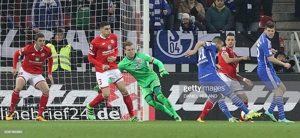 Schalke's French-Moroccan midfielder Younes Belhanda (3rd R) scores during the German first division Bundesliga football match of FSV Mainz 05 v Schalke 04 in Mainz, western Germany, on February 12, 2016. / AFP / DANIEL ROLAND /