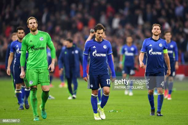 Schalke's goalkeeper Ralf Faehrmann Schalke's French midfielder Benjamin Stambouli and Schalke's defender Benedikt Hoewedes react after the UEFA...