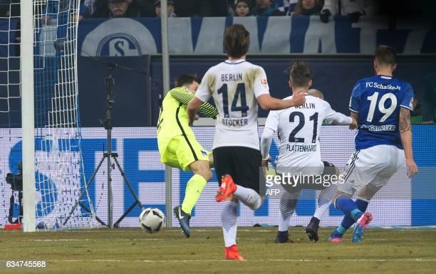 Schalke's Guido Burgstaller scores 10 past Hertha's Marvin Plattenhardt and goalkeeper Rune Jarstein during the Bundesliga match FC Schalke 04 vs...