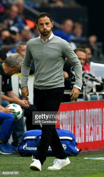 Schalke's head coach Domenico Tedesco gestures from the sidelines during the German First division Bundesliga football match FC Schalke 04 v RB...