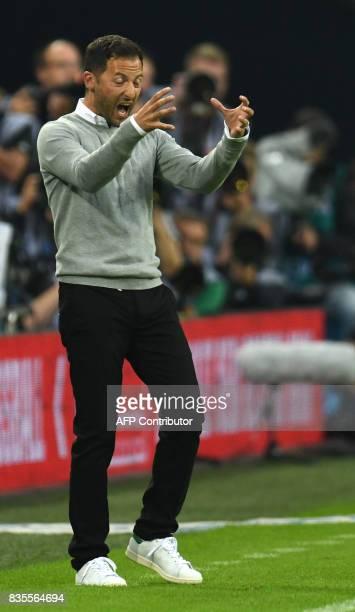 Schalke's head coach Domenico Tedesco reacts during the German First division Bundesliga football match FC Schalke 04 vs RB Leipzig in Gelsenkirchen...