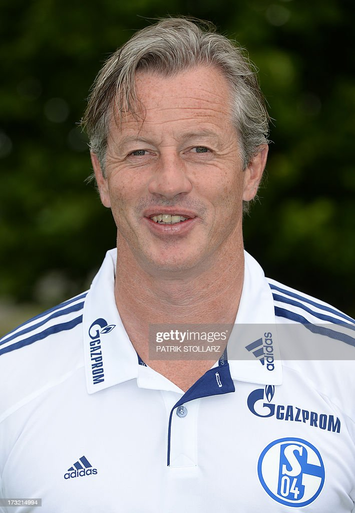 Schalke's head coach Jens Keller poses during a team photo call of German first division Bundesliga football club Schalke 04, on July 10, 2013 at the grounds of the former coal mine 'Consolidation' in Gelsenkirchen, western Germany.