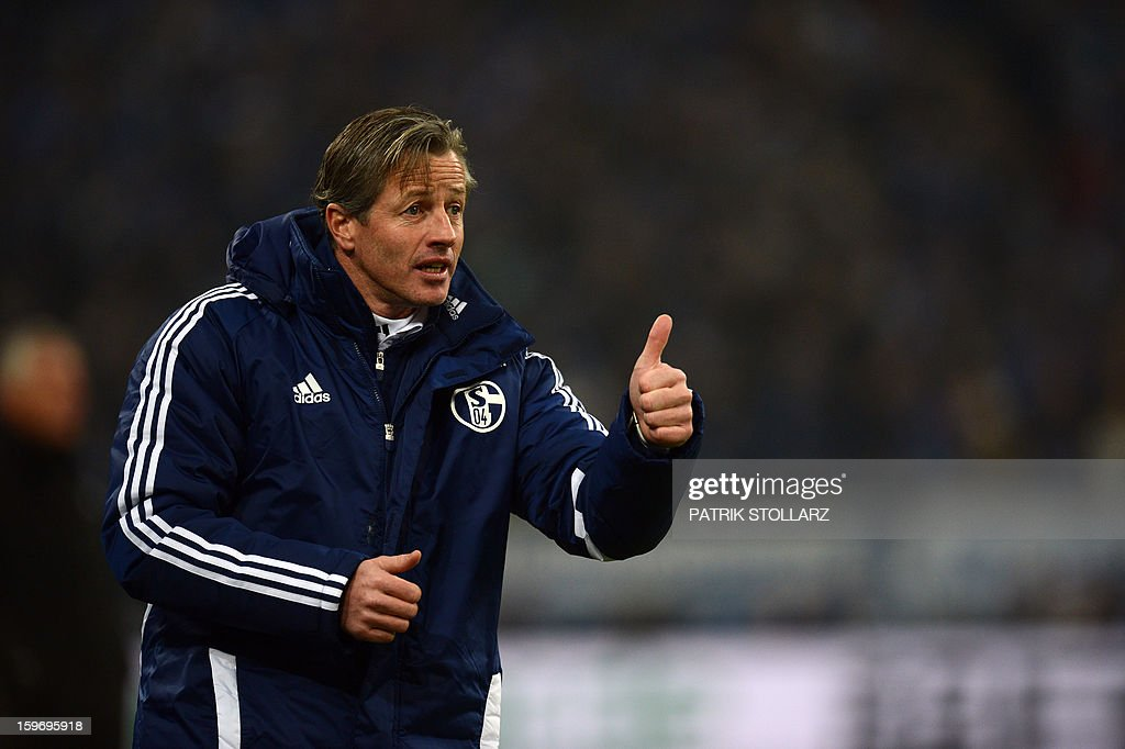Schalke's head coach Jens Keller reacts during the German first division Bundesliga football match FC Schalke 04 vs Hanover 96 on January 18, 2013 in Gelsenkirchen, western Germany