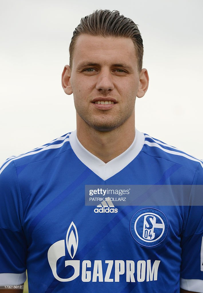 Schalke's Hungarian striker Adam Szalai poses during a team photo call of German first division Bundesliga football club Schalke 04, on July 10, 2013 at the grounds of the former coal mine 'Consolidation' in Gelsenkirchen, western Germany.