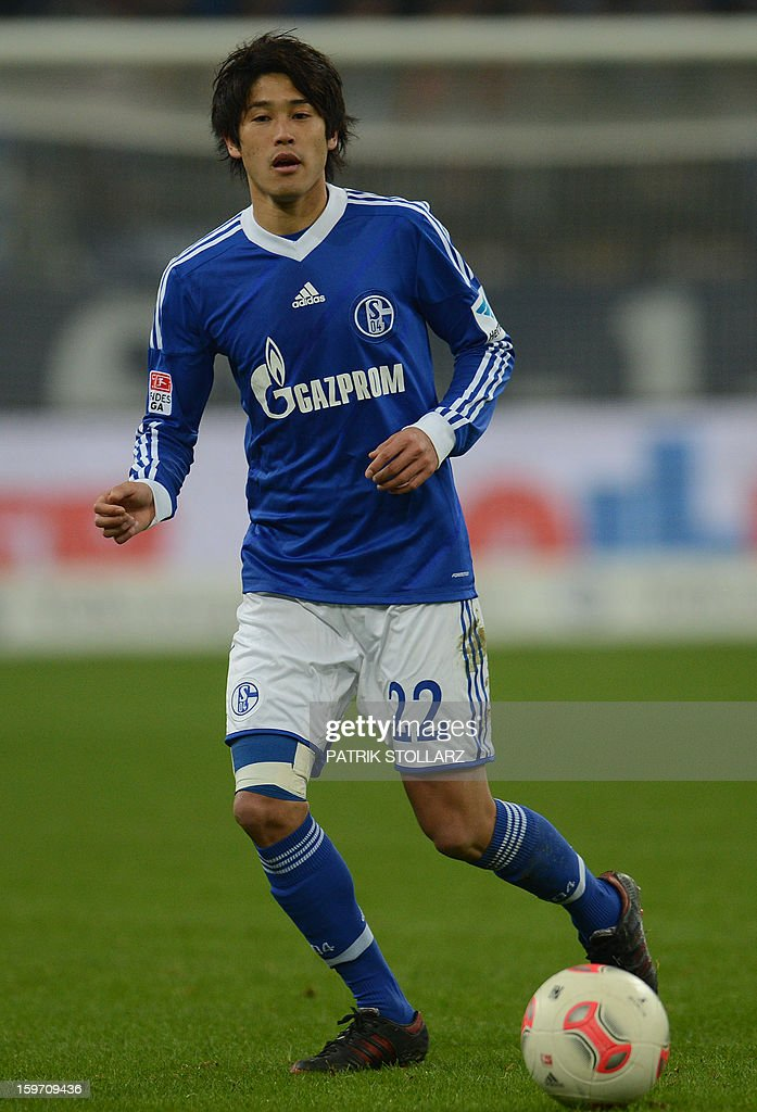 Schalke's Japanese defender Atsuto Uchida plays the ball during the German first division Bundesliga football match FC Schalke 04 vs Hanover 96 in Gelsenkirchen, Germany on January 18, 2013.