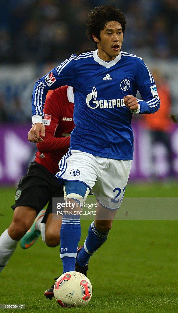 Schalke's Japanese defender Atsuto Uchida plays the ball during the German first division Bundesliga football match FC Schalke 04 vs Hanover 96 in Gelsenkirchen, Germany on January 18, 2013.