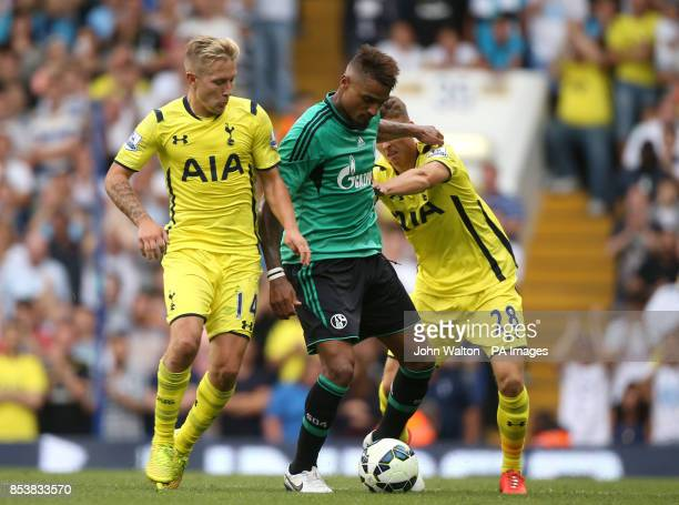 Schalke's KevinPrince Boateng battles for possession of the ball with Tottenham Hotspur's Lewis Holtby and teammate Thomas Carroll during the...