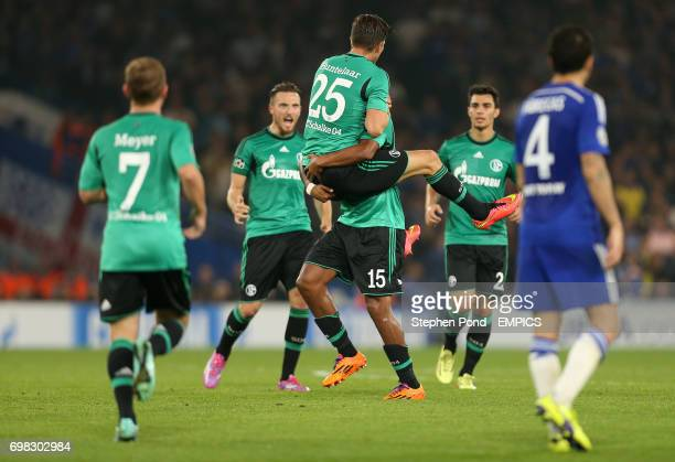 FC Schalke's KlaasJan Huntelaar is mobbed after scoring the equalising goal to level the match 11