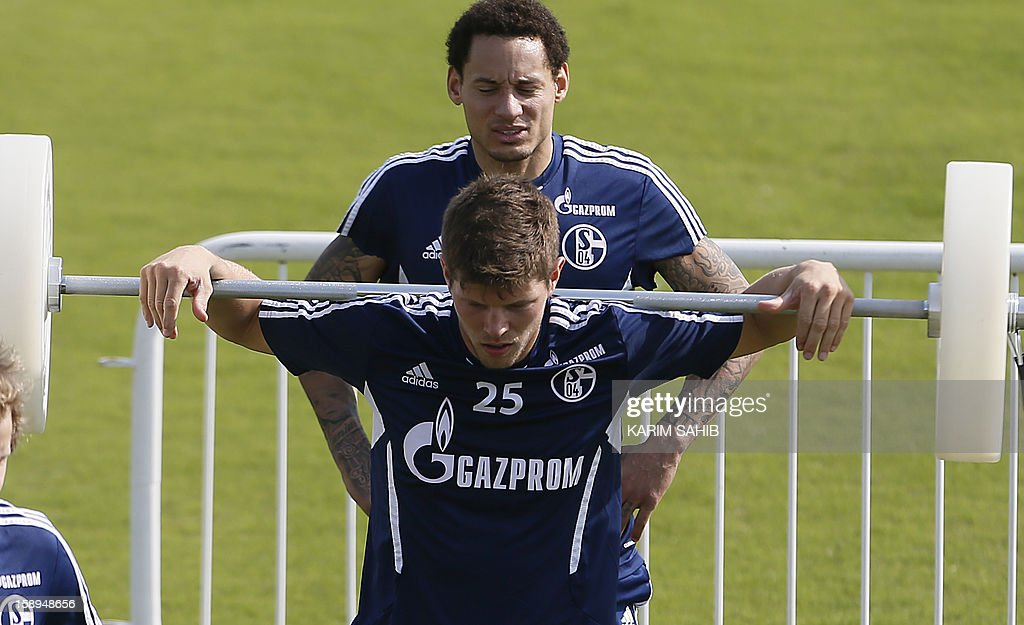 Schalke's Klaas-Jan Huntelaar lifts up weights during a training session at Doha's Aspire Academy in the Gulf emirate of Qatar on January 4, 2013. The German team is in Qatar for a week-long training camp during the winter break.