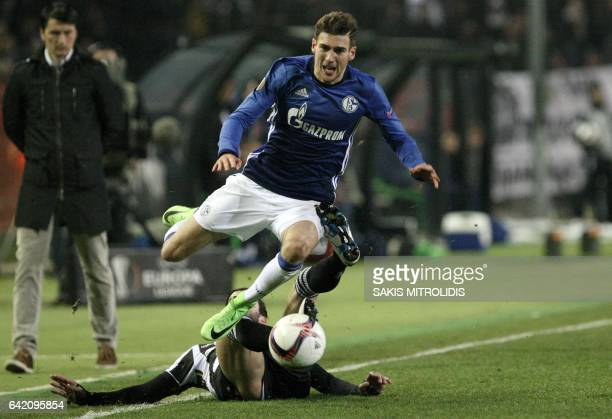 Schalke's Leon Goretzka vies with Paok's Jose Angel Crespo during the UEFA Europa League round of 32 first leg football match between Paok and FC...