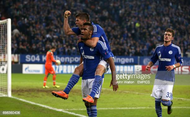 Schalke's Maxim ChoupoMoting is congratulated on scoring their winning goal of the game by teammmate Klaas Jan Huntelaar
