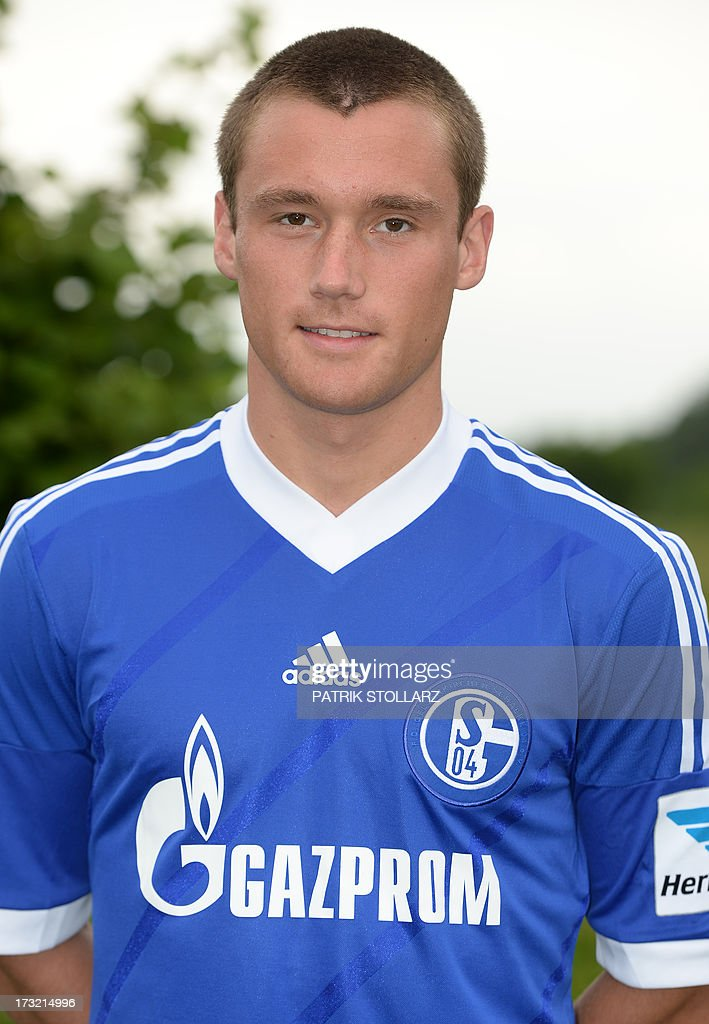 Schalke's midfielder Christian Clemens poses during a team photo call of German first division Bundesliga football club FC Schalke 04, on July 10, 2013 at the grounds of the former coal mine 'Consolidation' in Gelsenkirchen, western Germany. AFP PHOTO / PATRIK STOLLARZ