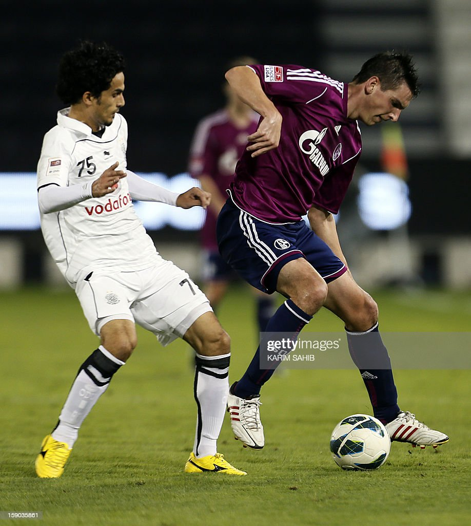 Schalke's midfielder Christoph Moritz (R) vies for the ball against Al-Sadd's Mohammed Omar during their friendly football match in Doha on January 6, 2013. Schalke is in Qatar for a week-long training camp before the beginning of the new season of the German Bundesliga after the winter break.