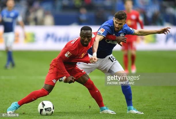 Schalke's midfielder Daniel Caligiuri and Leipzig´s Guinean midfielder Nabi Keita vie for the ball during the German first division Bundesliga...