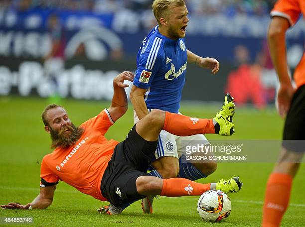Schalke's midfielder Johannes Geis and Darmstadt's striker Marco Sailer vie for the ball during the German first division Bundesliga football match...