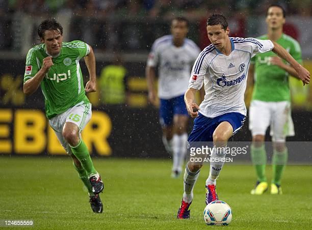 Schalke's midfielder Julian Draxler and Wolfsburg's midfielder Christian Traesch vie for the ball during the German first division Bundesliga...