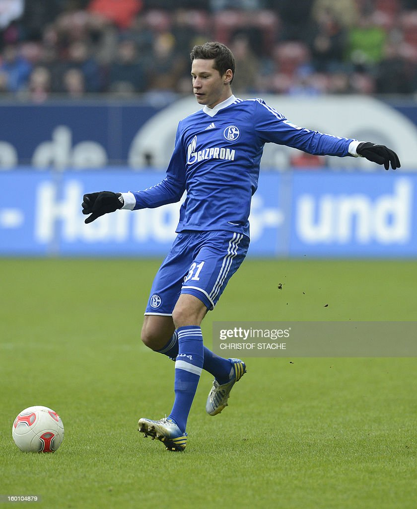 Schalke's midfielder Julian Draxler plays the ball the German first division Bundesliga football match FC Augsburg vs FC Schalke 04 in Augsburg, southern Germany, on January 26, 2013. AFP PHOTO / CHRISTOF STACHE AT + 49 69 650050