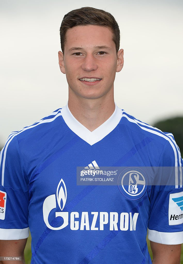 Schalke's midfielder Julian Draxler poses during a team photo call of German first division Bundesliga football club FC Schalke 04, on July 10, 2013 at the grounds of the former coal mine 'Consolidation' in Gelsenkirchen, western Germany.