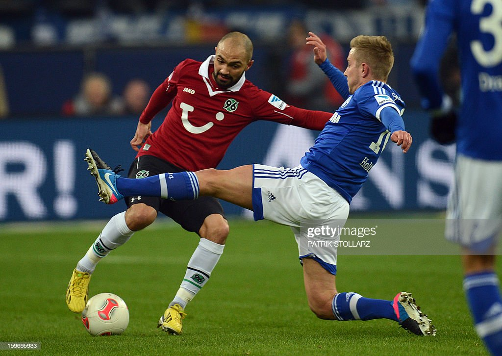 Schalke's midfielder Lewis Holtby and Hanover's defender Sofian Chahed (L) vie for the ball during the German first division Bundesliga football match FC Schalke 04 vs Hanover 96 on January 18, 2013 in Gelsenkirchen, western Germany