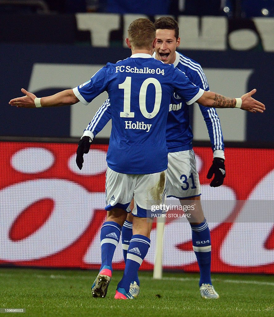 Schalke's midfielder Lewis Holtby and Schalke's midfielder Julian Draxler celebrate scoringl during the German first division Bundesliga football match FC Schalke 04 vs Hanover 96 in the German city of Gelsenkirchen on January 18, 2013.