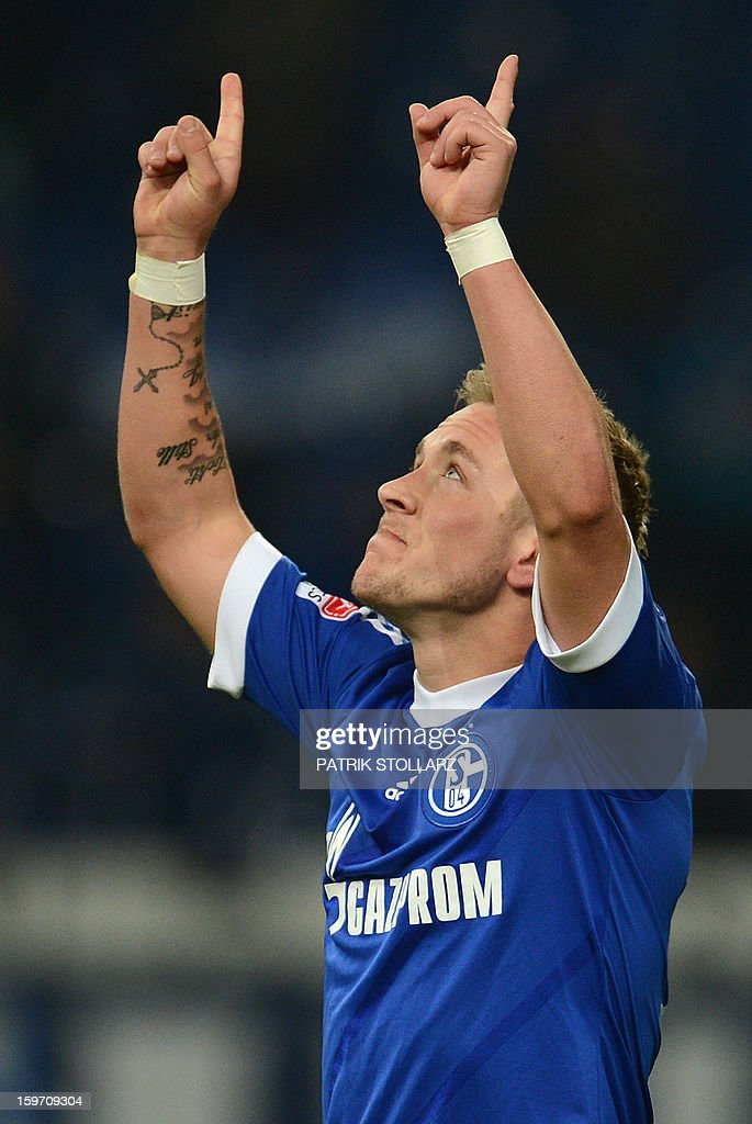 Schalke's midfielder Lewis Holtby celebrates during the German first division Bundesliga football match FC Schalke 04 vs Hanover 96 in the German city of Gelsenkirchen on January 18, 2013.