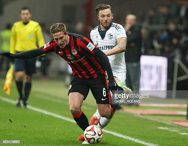 Schalke's midfielder Marco Hoeger and Frankfurt's defender Bastian Oczipka vie for the ball during the German first division Bundesliga football...