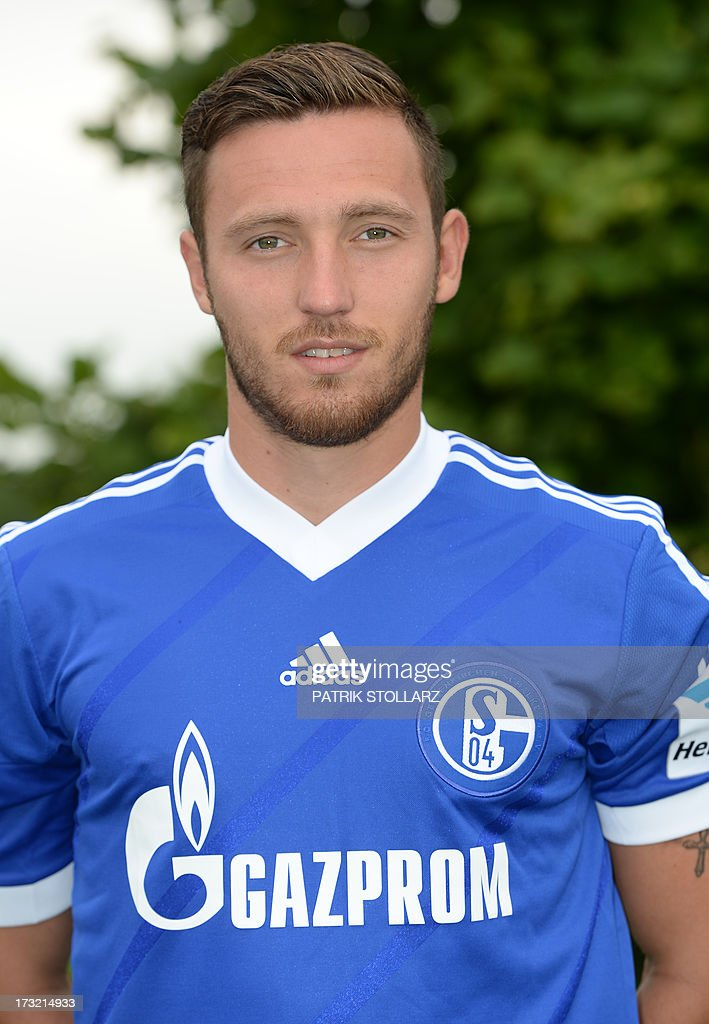 Schalke's midfielder Marco Hoeger poses during a team photo call of German first division Bundesliga football club Schalke 04, on July 10, 2013 at the grounds of the former coal mine 'Consolidation' in Gelsenkirchen, western Germany.
