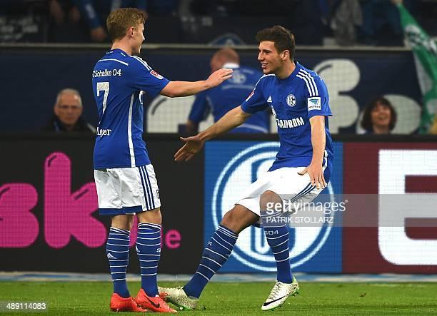 Schalke's midfielder Max Meyer and Schalke's midfielder Leon Goretzka celebrate after their team scored during the German first division Bundesliga...