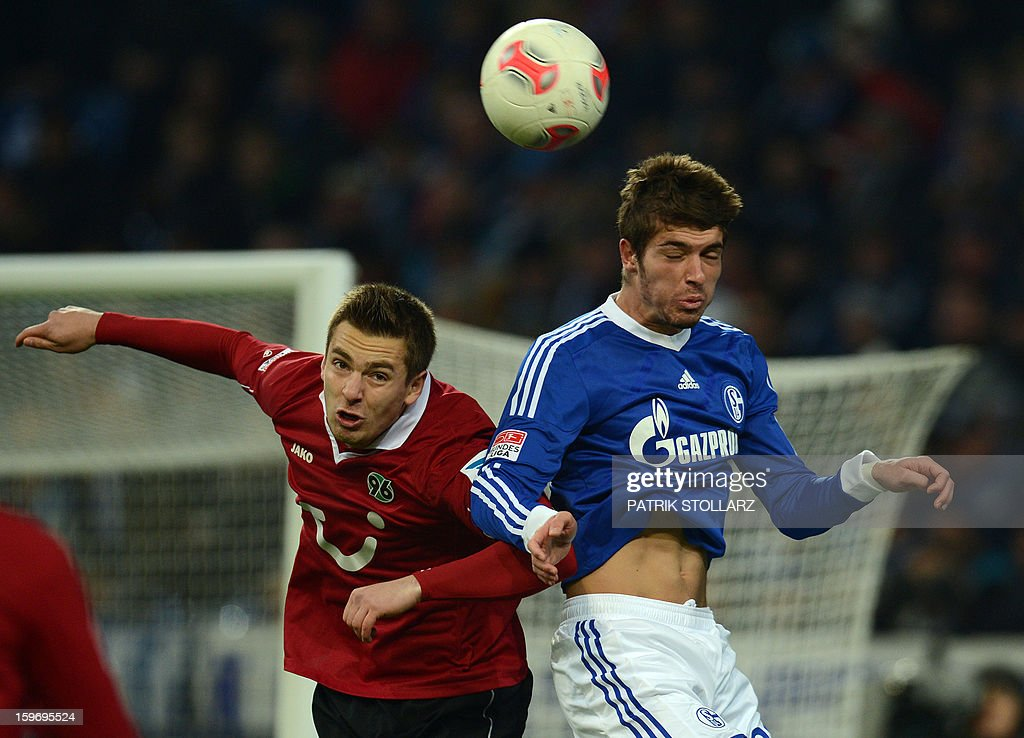 Schalke's midfielder Roman Neustaedter and Hanover's Polish striker Artur Sobiech vie for the ball during the German first division Bundesliga football match FC Schalke 04 vs Hanover 96 on January 18, 2013 in Gelsenkirchen, western Germany