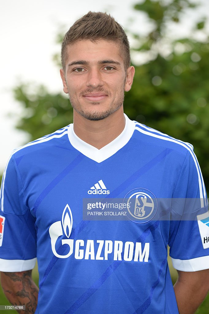 Schalke's midfielder Roman Neustaedter poses during a team photo call of German first division Bundesliga football club FC Schalke 04, on July 10, 2013 at the grounds of the former coal mine 'Consolidation' in Gelsenkirchen, western Germany.
