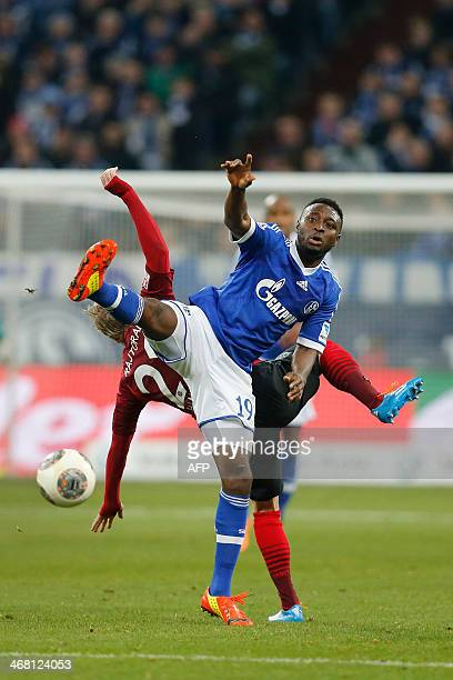 Schalke's Nigerian striker Chinedu Obasi vies for the ball with Hanover's Czech midfielder Frantisek Rajtoral during the German first division...