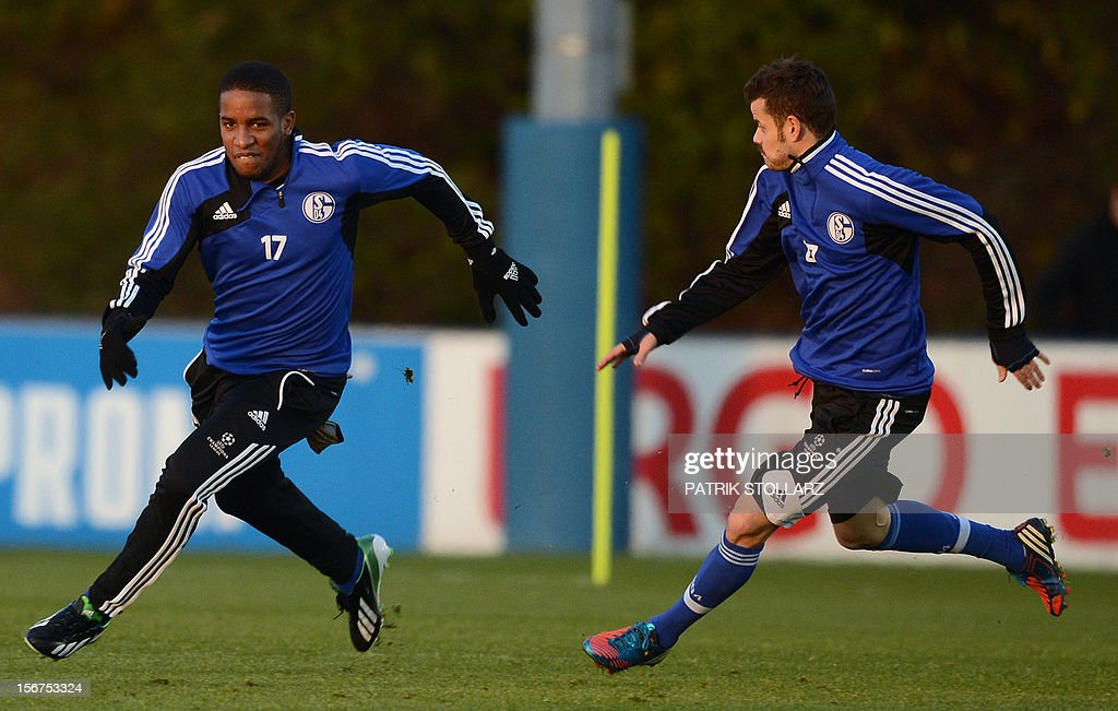 Schalke's Peruvian striker Jefferson Farfan (L) and Schalke's Swiss midfielder Tranquillo Barnetta warm up during a training session at the training ground, in Gelsenkirchen,western Germany on November 20, 2012, on the eve of the UEFA Champions League football match against Olympiacos Piraeus.