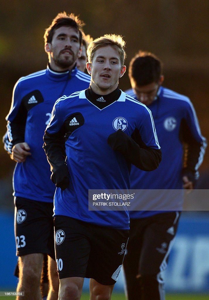 Schalke's players including midfielder Lewis Holtby (R) warms up warm up during a training session at the training ground, in Gelsenkirchen,western Germany on November 20, 2012, on the eve of the UEFA Champions League football match against Olympiacos Piraeus.