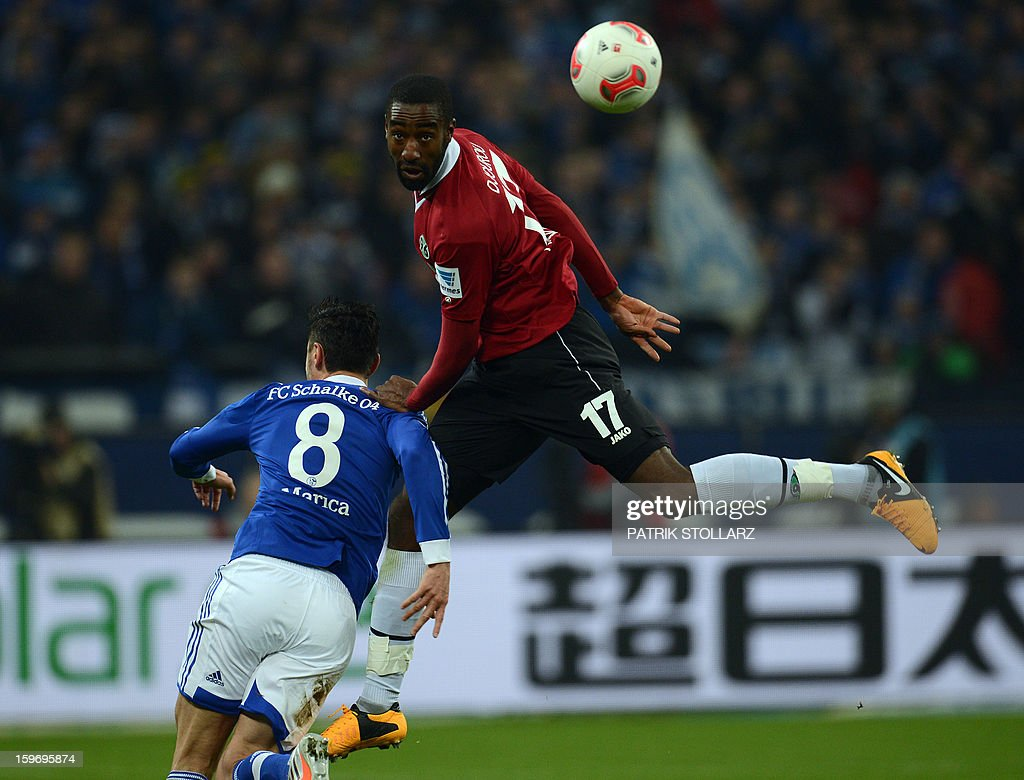 Schalke's Romanian forward Ciprian Marica and Hanover's midfielder Johan Djourou vie for the ball during the German first division Bundesliga football match FC Schalke 04 vs Hanover 96 on January 18, 2013 in Gelsenkirchen, western Germany