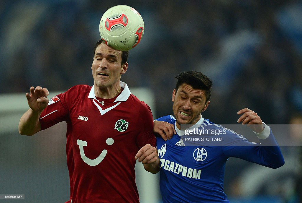 Schalke's Romanian forward Ciprian Marica and Hanover's Swiss defender Mario Eggimann (L) vie for the ball during the German first division Bundesliga football match FC Schalke 04 vs Hanover 96 on January 18, 2013 in Gelsenkirchen, western Germany